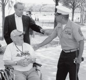 Above: Genter with Bob Dole, former U.S. senator from Kansas, and an unnamed marine sergeant, at the World War II Memorial. Dole is a disabled veteran of WWII. Top right: Genter at the United States Marine Corps War Memorial at Arlington National Cemetery. Below right: The Korean War Memorial depicts soldiers on patrol in rain ponchos, slogging up a hill. - courtesy photos