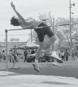 Archbold was the champion of both the girls and boys meets at the Lamberson Invitational, Saturday, May 10 in Montpelier. Top, Colin Shannon stretches to clear the bar in the high jump. He placed second. Below left, Emily Snyder goes airborne in the long jump. She finished sixth. Below right, Ian Cody lofts the shot put.- photos by  Mary Huber