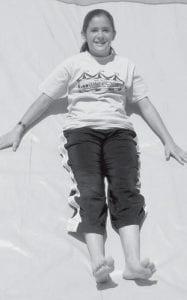 Mikala Avina, 11, Pettisville, rides on the big slide at the