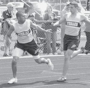 Breon Price takes the handoff from Nate Hammersmith in the 4x200 at Montpelier. The 800 relay team won the NWOAL championship last week.- photo by Mary Huber