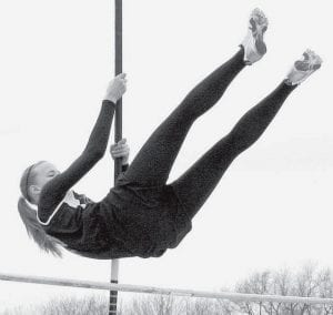 Stephanie Yoder set a school and league record in the pole vault at the BBC meet, Saturday, May 17. She vaulted a height of nine feet to win the event. The Pettisville girls fell four points short of winning the meet, finishing second.- photo by D.J. Neuenschwander