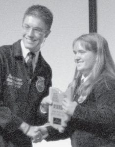 Rebekah Meller, a member of the Pettisville FFA chapter, receives a first place award in the food science and technology proficiency at the 2008 state FFA convention.-  courtesy photo