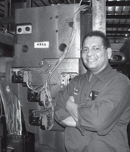 Tom Trejo, on the job at CK Technologies in Montpelier. Once homeless with an alcohol problem, Trejo turned his life around and graduated from Northwest State Community College. He also was promoted to a new job. The company manufactures plastic parts for heavy trucks, and for certain military vehicle applications.- courtesy        photo