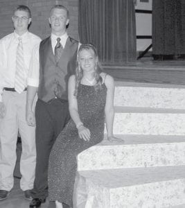 At right: Tim Spiess and Lucas Nofziger, PHS juniors from left, built the steps to the stage that were used at the 2008 PHS Prom. With them is Hannah Beck, a PHS senior and Nofziger's date for the evening. Below: Enjoying good conversation and good friends are PHS juniors, sitting from left: James Baatz, Rebekah Meller, Rachel Fry, Brianna Holstopple, Yu Lin- LIn Huang, and Bethany Hartz. Between Holsopple and Huang is Wyatt Andersen, a friend of LinLin's from Minnesota.- photos      by Mary Huber