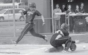 Stacy Wyse crosses the plate on a Dani Newman pop-up in Archbold's 12-1 district championship victory over Fairview. Wyse hit a long two-run homer over the center field fence in the fifth inning.-  photo by Mary Huber