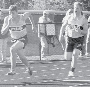 Nate Hammersmith, left, gets ready to take the handoff from Jacob Fidler.- photo by Jack Frey