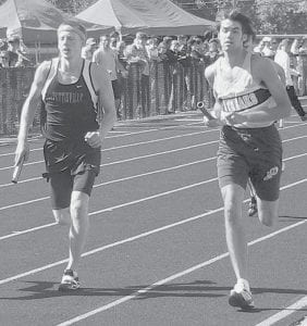 Pettisville's Austin Borton, left, and Archbold's Colin Shannon race to hand off the baton to teammates in the 4x800 at the regional track and field meet. Pettisville advanced to state competition with a thirdplace finish; the Streaks finished seventh.- photo by Jack Frey