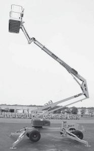 One of the two models of X-Boom aerial work platforms, manufactured in Archbold by Bil-Jax, stands partially extended. In the background are more platforms waiting delivery. The X-Boom fills a niche in the market like no other machine.- photo by David Pugh.