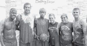 THE FAM, a team made up of members of West Clinton Mennonite and Pettisville Missionary churches, won the Bullfrog Division of the Oozeball mud volleyball tournament during the Black Swamp Benefit at the Fulton County Fairgrounds. The team also won the contest in 2006. Players included, from left: Tyler Woolace, Justin Rufenacht, Gabe Ruffer, Megan Boetz, Mandy Boetz, and Tom Short. About 200 players took to the mud on Saturday, June 21. The tournament raised about $2,500.-  courtesy photo