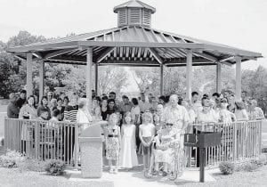 Members of the Lockport Mennonite Church congregation fill the new gazebo-style picnic shelter, built on church property, during the June 15 dedication ceremony. The shelter was built to honor the late Walter Stuckey, Lockport pastor from 1938 to 1981. He died in 2005. At the front right of the entrance is Virgie Stuckey, Walter's wife. Behind her is their son, Bill. The shelter is located across from the Lockport Covered Bridge on Williams County Rd. 21-N. - courtesy ph oto