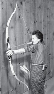 Gertrude Hitt, champion archer, draws her bow. She was active in the sport in the late 1950s and 1960s. - courtesy photo