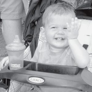 Carter Kruse, 14 months, son of Chad and Michelle, Ridgeville Corners, was having a great time watching the fun from his stroller at the Ridgeville Community Day, Sunday, July 20.-  photo by Mary Huber