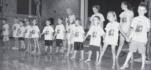 Music was in the air at the Black Swamp Arts Council Creative Arts Camp, July 14-18 at the Archbold Middle School. Youngsters formed a line to sing the chorus of their song about looking for rain forest animals. The theme this year was
