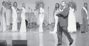 Robert Freeman, Ridgeville Corners, on stage with the finalists in the Miss Sudan beauty pageant. The event was held in Kansas City, Mo. early last month. It was the first time a Miss Sudan had been selected. Freeman got involved in it after meeting the pageant founder in connection with a writing project.-  courtesy photo