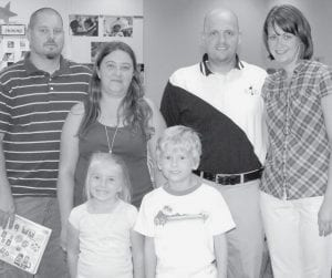 Adriana Thompson and Levi Baus were exploring their kindergarten classroom during the Monday, Aug. 18 Archbold Elementary School Open House with their parents, Todd and Kelly Thompson and Chad and Beth Baus, back row from left. The children are in Mrs. Warner's class. Todd, Kelly, and Chad graduated together from Archbold High School in 1990; their children are members of the AHS Class of 2021.-  photo by Mary Huber