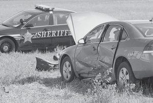 A car driven by Tacia R. Muehfeld, 18, Edon, ran into a field on the southeast corner of the intersection of St. Rt. 34 and Henry County Rd. 24 after it collided with a minivan Monday, Aug. 25. Three persons, including Muehfeld, were taken to area hospitals; all were treated and released.-  photo by David Pugh