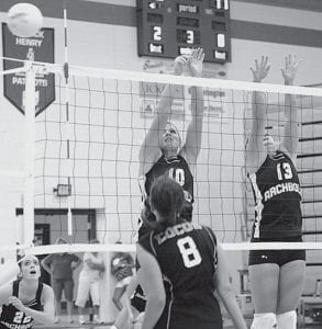 Stacy Wyse (10) and Devin Newman (13) go up for a block in an NWOAL volleyball game against Montpelier, Tuesday, Aug. 26. The Montpelier spiker tried to hit the ball down the line, but the ball bounced off the out-of-bounds pole instead.-  photo by Mary Huber
