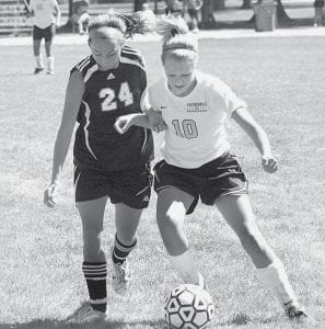 Blue Streak Carley Wyse (10) fights off an Otsego Knight to keep control of the ball. AHS beat the Knights 5-1.- photo by Scott Schultz