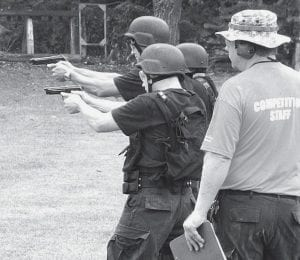 Members of the Corrections Center of Northwest Ohio Special Response Team, or SRT, compete in the firearms portion of the Ohio Tactical Competition. The event, for police and other law enforcement agencies, features five events, including firearms competitions and an obstacle course. CCNO won the overall title, earning the right to compete at the national level.-  courtesy photo