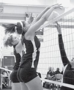 Devin Newman, left, and Hailey Galvan block the spike of an Otsego player at the Streak Spike-Tacular, Saturday, Sept. 27. AHS finished fourth in the tourney.- photo by Mary Huber
