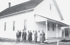Above: West Clinton Mennonite Church was constructed in 1908. This is how the church appeared before the building was expanded and renovated in 1935. At left: the church as it appeared after the renovation and expansion. The original building was demolished in 1968, when the current church building was constructed. The cost to build the church in 1908 was less than $2,700.-  courtesy photos