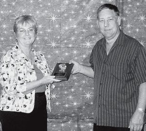Melanie Nagel receives the 2008 Mary Short award from Ed Mooney, 2007 winner. It was presented at the Archbold Community Theatre annual meeting at Giffey Hall, Monday, Oct. 6.-  courtesy photo