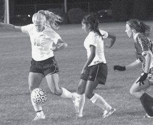 Autumn Lantz (11) scored a goal at Delta, and Jessica Ramirez, center, scored twice against Waite in Archbold's two victories last week.-  photo by Scott Schultz