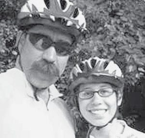 Rob Nofziger and his daughter, Rebekah, wearing their bicycle helmets. The pair decided to ride their bikes to Eastern Mennonite University in Harrisonburg, Va., as a last father-daughter trip before Rebekah started college. -  courtesy photo