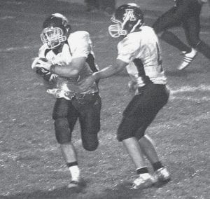 Jake Fidler takes the handoff from quarterback David Rupp in the first half of the Streaks' NWOAL contest against Liberty Center. Fidler was held to 41 yards rushing on the night, but led AHS with 92 yards receiving. The two squads meet again Saturday night at Tiger Stadium for the first round of the Div. V playoffs.- photo by Scott Schultz