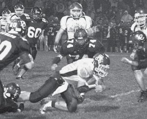 A Liberty Center defenseman makes a shoestring tackle, bringing down Rupp. The AHS senior led the Streaks' ground game with 138 yards.-  photo by Scott Schultz