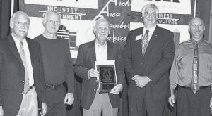 From left: Tony Rupp, Tim Rupp, Bill Rupp, Siebenmorgen, and Phil Rupp with Rupp Furniture's 100-year award.- photos courtesy Royal Images