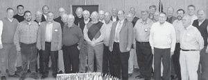 Past and present Lions Club members at the 50th anniversary party. Front row, from left: Kenny Cowell, Mike Short, Dean Kinsman, Randy Volkman, Ron Lantz, Lonnie Short, Bob DeVries, Jim Ziegler, Cal Short, charter member. Second row: Brad Short; Jerry Rohrs; Marv Nafziger; Harold Plassman; Richard Riegsecker; Dale Pape, charter member; Karlin Wyse; John Poulson; George Jelen. Back row: Joe Short; Carrol Wolf; Elden Badenhop; Don
