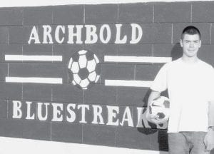 Chandler Tinsman stands in front of the kicking wall he built for the soccer program of the Archbold Parks and Recreation Department. The wall gives youngsters something to kick a ball against for practice. It replaces an old wall made of plywood, and an old soccer goal. Tinsman, 15, took on the project for a community service project for an Eagle Scout rank. - courtesy photo
