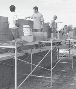 Chandler Tinsman, and others, at work on the soccer wall. The wall is located in Woodland Park, where the village soccer program is concentrated. Tinsman said he received donations of cash and materials to construct the wall. While the Archbold Park Board pledged up to $500 to the project, Tinsman was able to finish the project without using any Park Board money. - courtesy photo