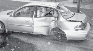 Bethany J. Morgan, 18, West Unity, lost control of her car when she rounded the curve on US20A at Co. Rd. G, Monday morning, Nov. 24, and struck a utility pole. Archbold Rescue transported Morgan to Archbold Hospital. Andy Brodbeck, Archbold fire department chief, said none of the accidents that day resulted in serious injuries.-  photo     by David Pugh