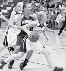 Alexa Short passes a Viking and drives to the basket. She scored 15 points in Pettisville's 50-45 non-league victory over Evergreen, Monday, Dec. 8.- photo by Mary Huber
