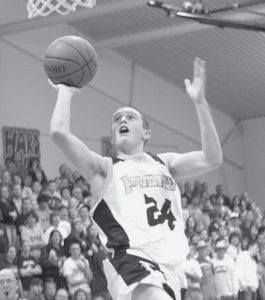 Quinn Nofziger drives for a layup against Archbold, Saturday, Dec. 27.-  photo by Mary Huber