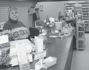 Bette Kohv, behind the counter at Scrapbook Korner. Her store is the only independent retail scrapbooking store in the area. It draws customers from across Northwest Ohio. The store stayed in the same building, but moved into a larger space, over the New Year's holiday. -  photo by David Pugh