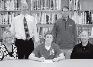 Quinn Nofziger, Pettisville High School senior, signed a letter of intent to play baseball at Indiana Wesleyan University, Marion, Ind. Seated with Nofziger, center, are his parents, Cheryl and Douglas. Standing are Paul Bishop, PHS baseball coach, left, and Chad Newhard, IWU coach.-  photo courtesy PHS yearbook