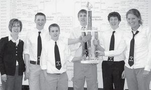 Lockport 1 was the champion of the 2009 Ohio/ Pennsylvania/Virginia Bible Quiz tournament over the weekend at Archbold High School. Standing in front of the 79-team tournament bracket board from left: Patsy Miller, coach; Seth Nofziger, Derek Miller, Wesley Short, Eliot Nofziger, and Kristi Frank.-  courtesy photo