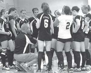 John Horning, Pettisville head volleyball coach, gives his team instructions during a time-out.– photo by Sc ott Schultz