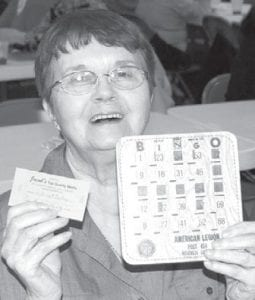 """Phyllis Weber, rural Pettisville, made history at the Ridgeville Feather Party, Friday, Nov. 20. Weber said she's attended the event 10 years and had never won, but Friday was her lucky day, and she finally got to yell """"bingo.""""–photo by Mary    Huber"""