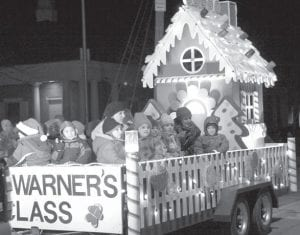 The float with Mrs. Warner's Kindergarten Class is always a favorite in the Archbold Parade of Lights.–photo by Mary    Huber