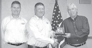 Toby Hines, Archbold, right, representing the Ohio Department of Transportation, accepts the 2009 Booster of the Year award from the Fulton County Soil and Water Conservation District. The award is presented to an individual or group that has greatly benefited the Fulton SWCD by promoting the district's various programs. Presenting the award from left are Pete Carr, district technician, and Bill Shininger, board supervisor.– courtesy photo