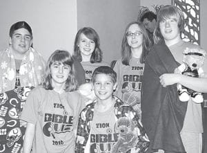 """Dressing in pajamas, carrying pillows and dozing off at the end of their team cheer, """"Fallen Asleep,"""" Zion's Bible Quiz team, won a team spirit award for displaying their team name. But when it came to quizzing, the team was wide awake as they scored 425 points and won all three matches. Members are, front row from left: Katie Yoder, Josh Leichty, Jonny Lantz. Back row: Zack Zimmerman, Meg and Hannah Short.–courtesy        photo"""