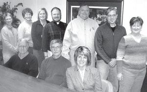 These men and women are the officers and trustees for the Archbold Area Foundation for 2010. Seated, from left: Karlin Wyse, president; Steve Brink, treasurer, and Jodi Herman, secretary. Standing, from left: Rachel Kinsman, Nancy Hogrefe, Jackie Schnitkey, Paul Reichert, Artie Short, Jeff Fryman, and Julie Nofziger, trustees. Not pictured: Marc Fruth, vice president; Harold Plassman, trustee.– photo by David Pugh