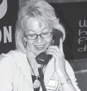 Linda Parnell, Archbold, was one of many volunteers assisting with the annual Fulton County Heart Radiothon, Thursday, Feb. 11. The event raises money for heart-related equipment and training in the county.–photo by  David Pugh