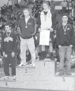 Jordan Cowell takes his place as the second-place finisher in the 135-lb. weight class at the Div. III district meet, Saturday, Feb. 27. South Central's Payton Oney was the 135-lb. district champion. Also advancing to state are, Damen Escobedo, Gibsonburg, fourth, and Cal Clark, Monroeville, third.–photo by Scott Schultz