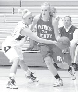 Archbold's Stacy Wyse, left, knocks the ball away from Patrick Henry's Megan Michaelis (34) after Michaelis inbounded the ball in the second half of their Div. III sectional final.–photo by  Mary Hube r