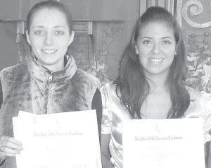 Alyssa Mann, a Pettisville senior, left, and Olivia Molina, a Fayette senior, received Good Citizen awards recently from the Elijah Gunn Sr. Chapter of Daughters of the American Revolution in Henry County.– courtesy photo